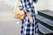 With light brown bag and sandals