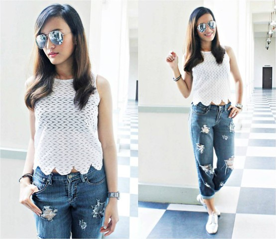 With loose jeans and white sneakers