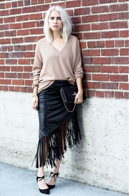 With loose shirt, black shoes and black leather clutch
