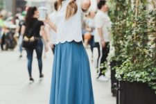 With midi skirt and beige high heels