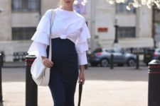 With navy blue midi skirt, white sneakers and white bag