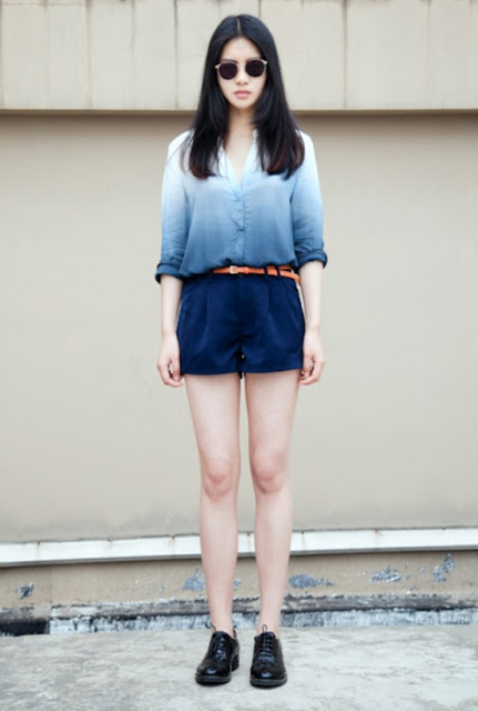 With navy blue shorts, brown belt and black lace up flat shoes