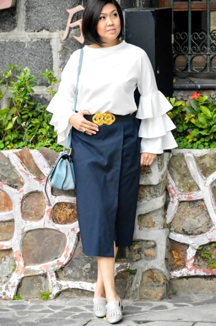 With navy blue wrap midi skirt, light gray shoes and blue bag