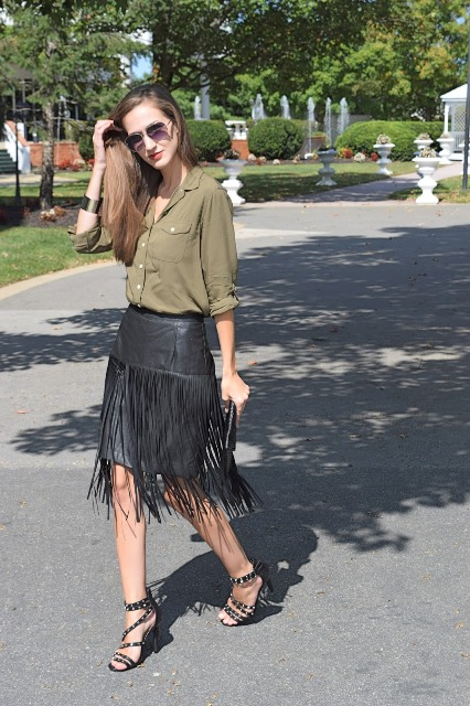 With olive green button down shirt, high heels and clutch