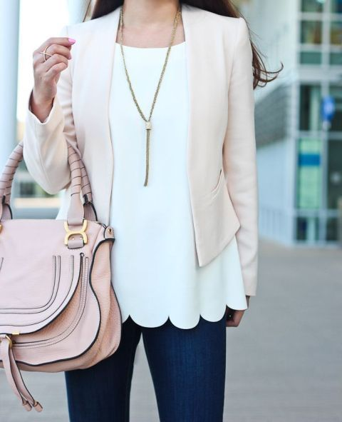 With pale pink blazer, jeans and pale pink bag