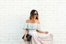 With pleated skirt, high heels and black clutch