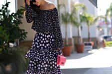 With polka dot midi skirt, red mini bag and high heels
