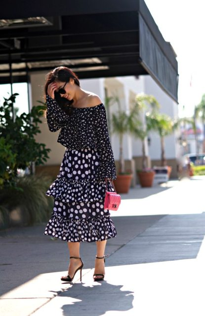 With polka dot midi skirt, red mini bag and high heels