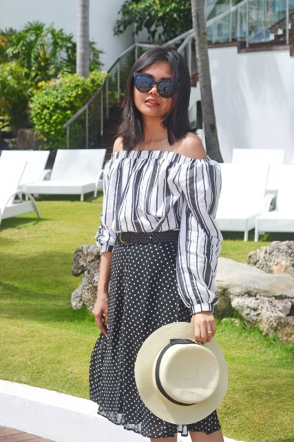 With polka dot skirt and hat