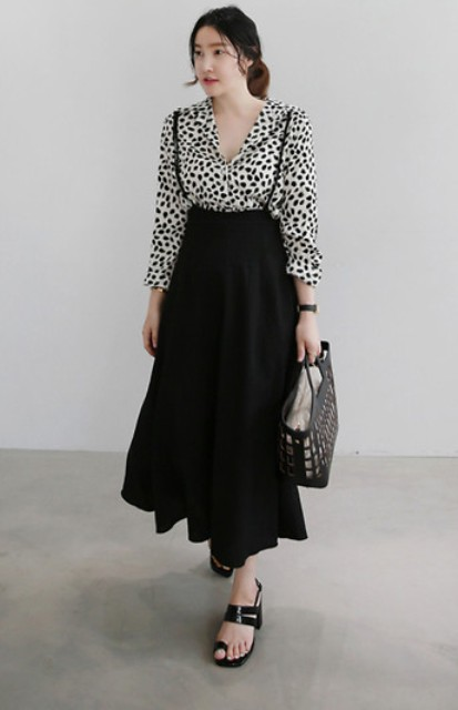 With printed blouse, midi skirt and bag