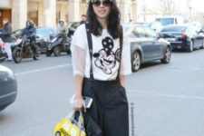 With printed t-shirt, silver sneakers and black leather jacket