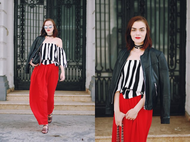 With red pants, sandals, clutch and black leather bag
