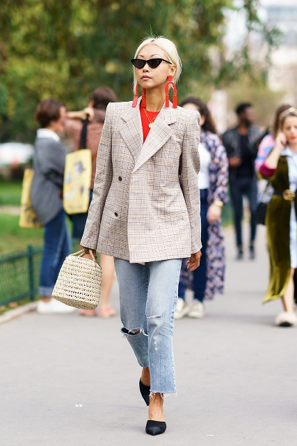 With red shirt, checked blazer, distressed jeans and black shoes