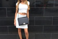 With scallop skirt, black chain strap bag and flat sandals
