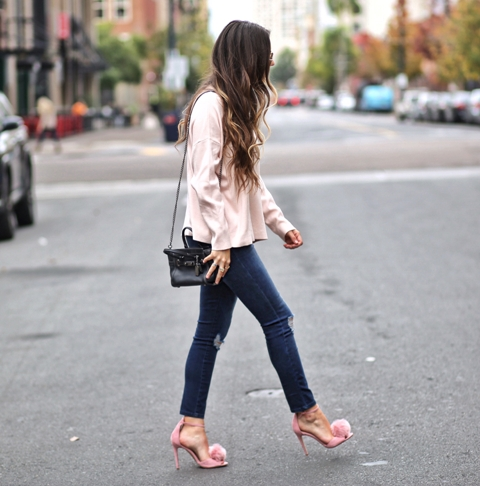 With shirt, skinny jeans and black bag