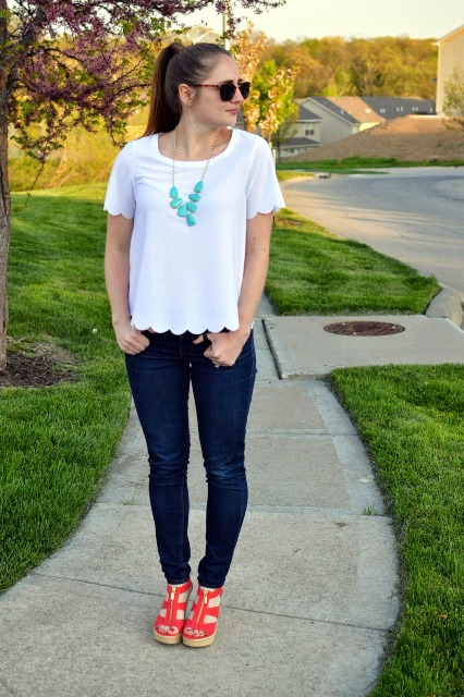 With skinny jeans and red platform sandals