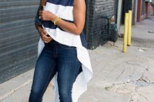 With skinny jeans, beige pumps and clutch