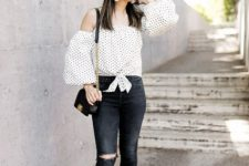 With skinny jeans, black mini bag and white shoes