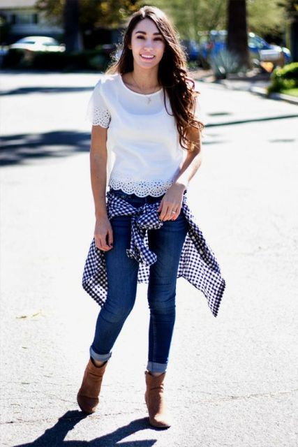With skinny jeans, checked shirt and ankle boots