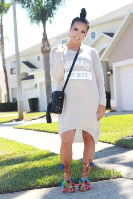 With sporty dress and black leather crossbody bag