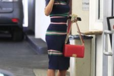 With striped dress and red bag