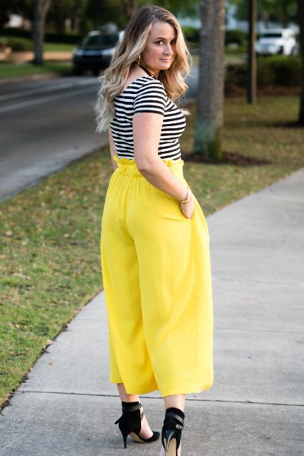 With striped shirt and black high heels