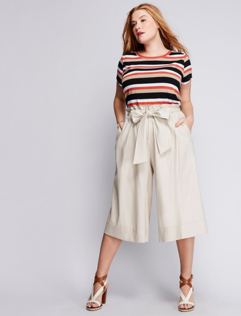 With striped shirt and white and brown sandals