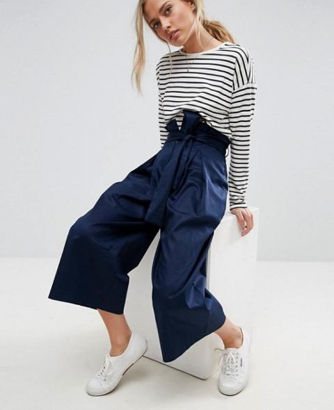 With striped shirt and white shoes