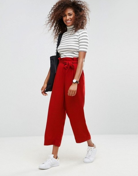 With striped turtleneck, white sneakers and black tote