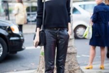With sweater, flat shoes and black bag