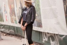 With t-shirt, jacket, hat, striped pants and tote