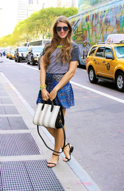 With t-shirt, printed mini skirt and two colored bag