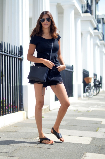 With t-shirt, shorts and navy blue crossbody bag