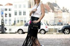 With white blouse, black bag and white sneakers