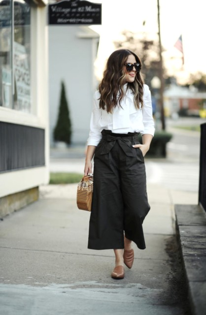 With white blouse, brown mules and straw bag