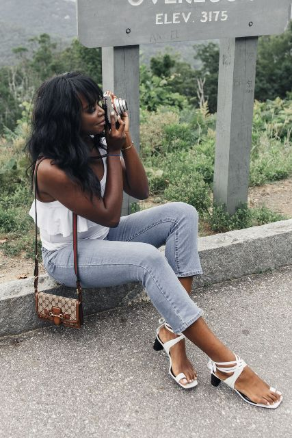 With white blouse, skinny jeans and printed mini bag