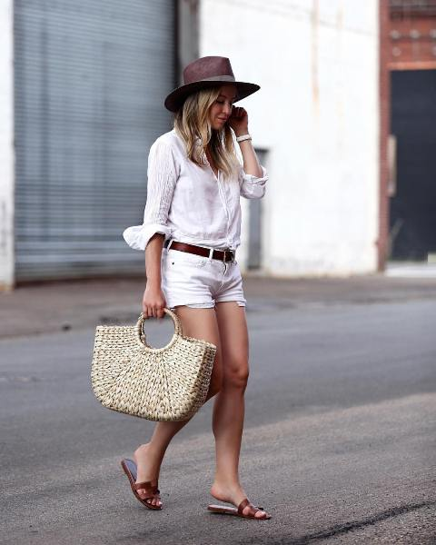 With white button down shirt, white shorts, brown hat, brown belt and sandals