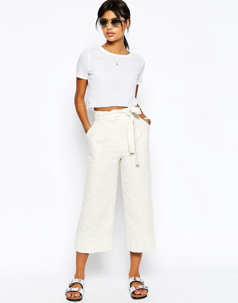 With white crop t shirt and silver flat sandals