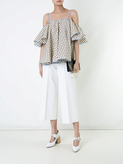 With white culottes, black clutch and white shoes