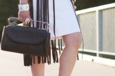 With white dress, black heels and bag
