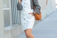 With white dress, platform sandals and brown bag