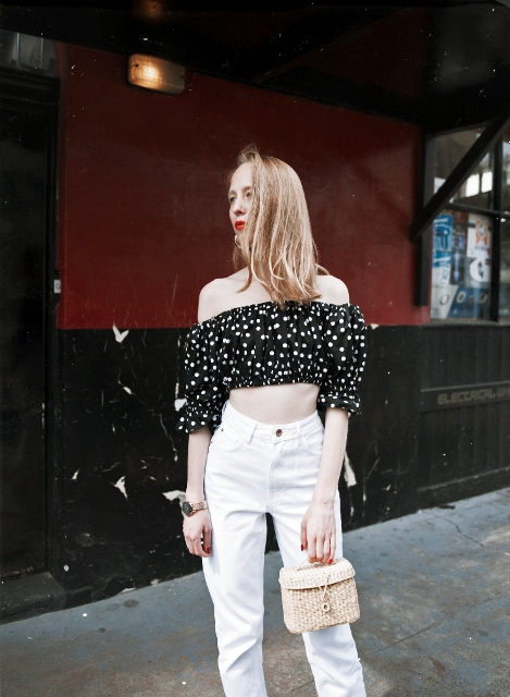 With white high-waisted pants and mini bag