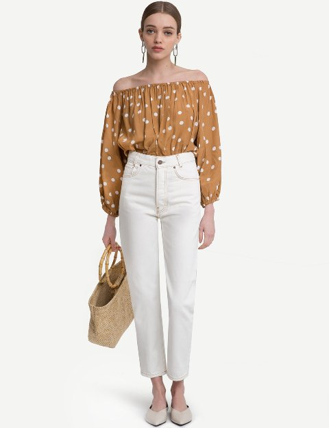 With white jeans, straw bag and beige flat shoes