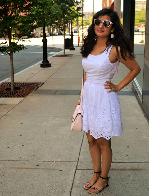 With white lace dress and pale pink bag