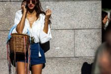 With white loose blouse and navy blue shorts