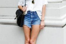 With white loose shirt, denim shorts and black bag
