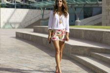 With white loose shirt, pumps and chain strap bag