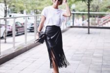 With white loose t-shirt, cutout boots and black bag