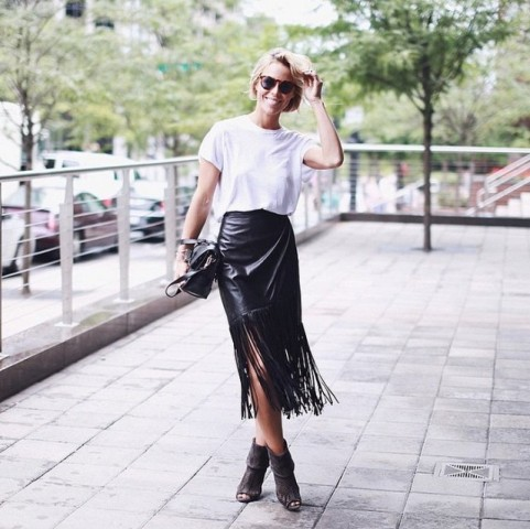 With white loose t shirt, cutout boots and black bag