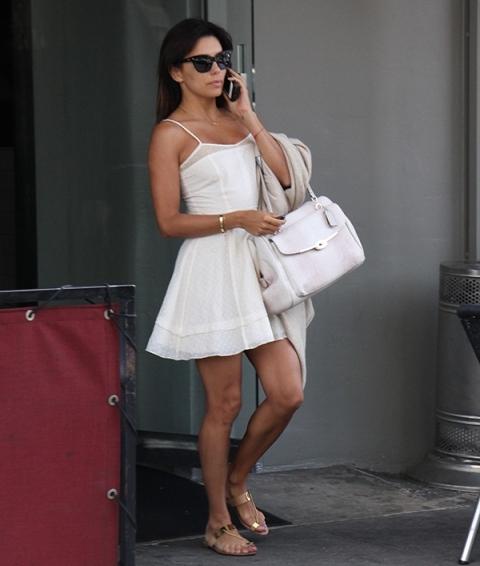 With white mini dress and white bag